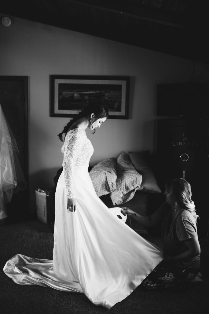 bride at final fitting for bridal alterations in La Grande, Oregon