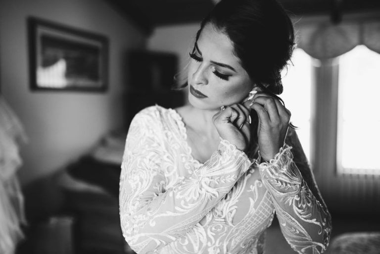 bride on wedding day after wedding dress alterations by Modern Cottage