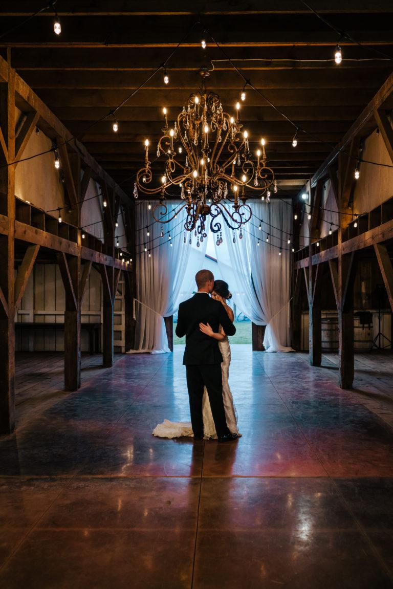 groom wearing tuxedo rental at White Barn Estate