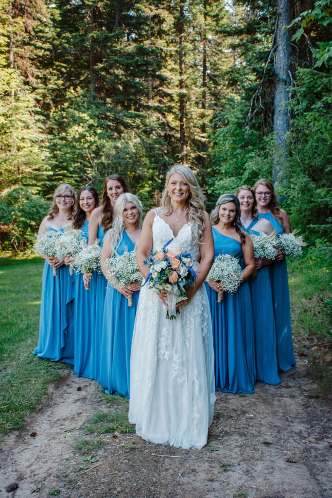 Photo of bridesmaids in blue dresses at a forest wedding