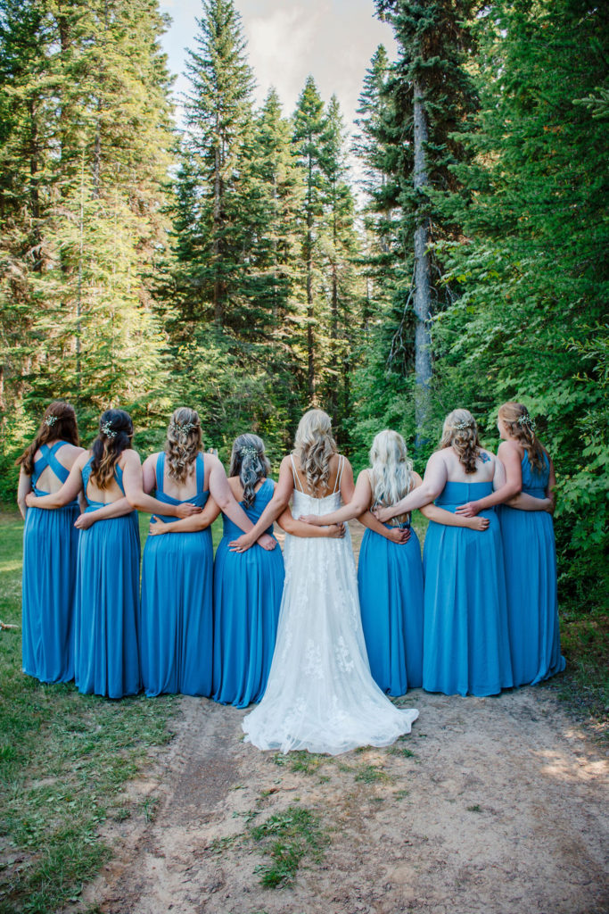 Photo of bridesmaids in blue dresses in a forest wedding