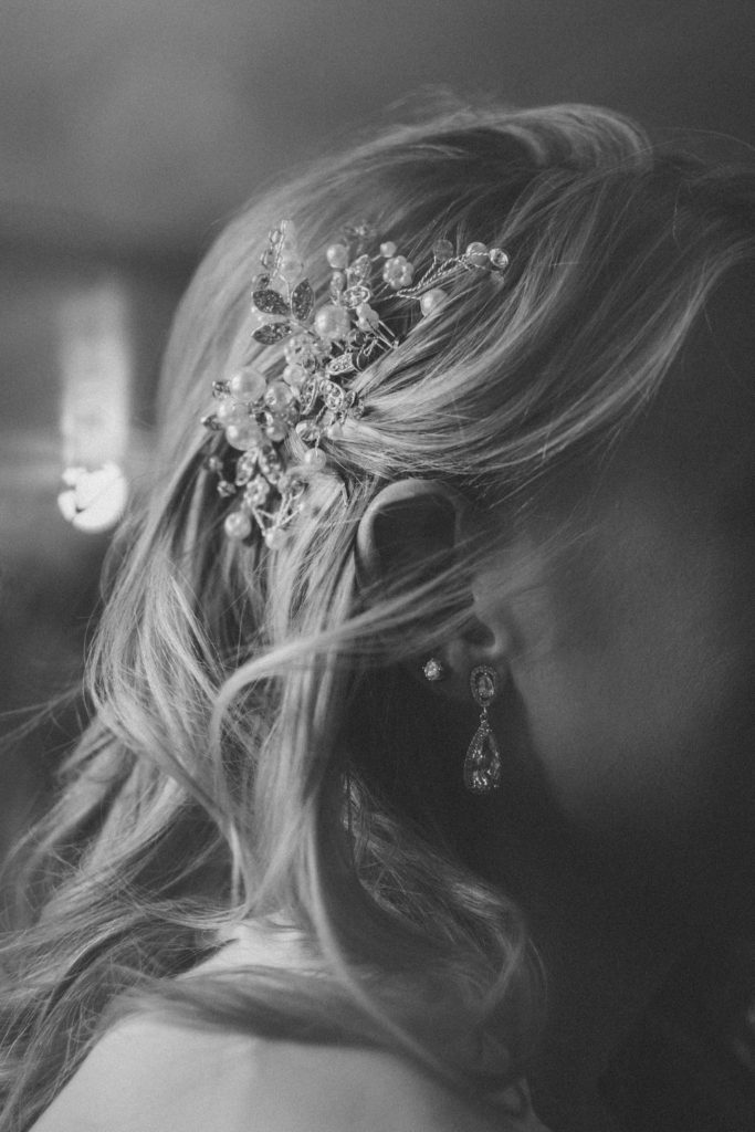 Photo of bride with hair down and broach