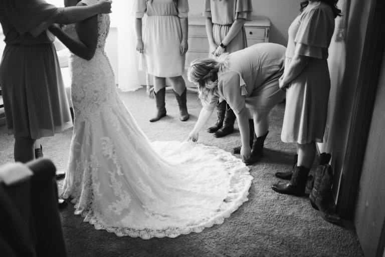 Bride during alterations fitting in La Grande